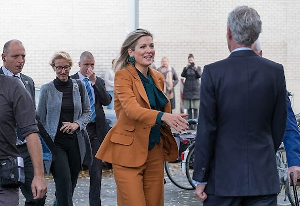 Queen Maxima wore Claes Iversen Pan-Suit from the AW2015 the collection and Gucci Silk Shirt Blouse, Natan Earrings