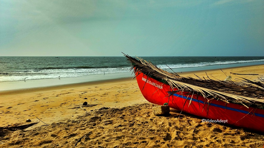 red Boat on Seashore