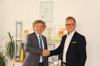 RE/MAX Immobilienmakler Bernd Mergenthaler und Christoph Buck