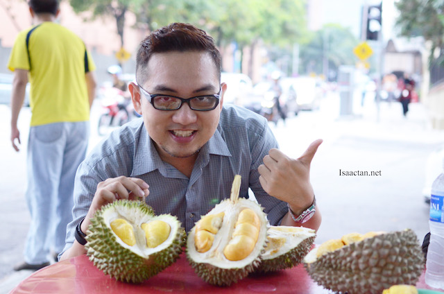 Enjoying my durians by the roadside at Bukit Bintang area.