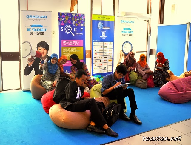 Graduates and visitor to the TalentCorp Sector Focused Career Fair 2013 taking a break