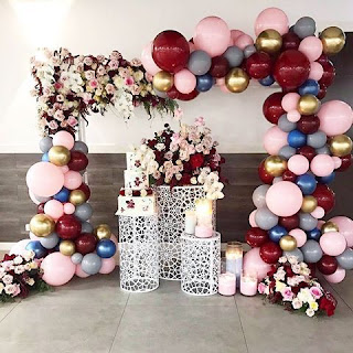 Burgundy, gold, blush, champagne balloons and flowers organic arch