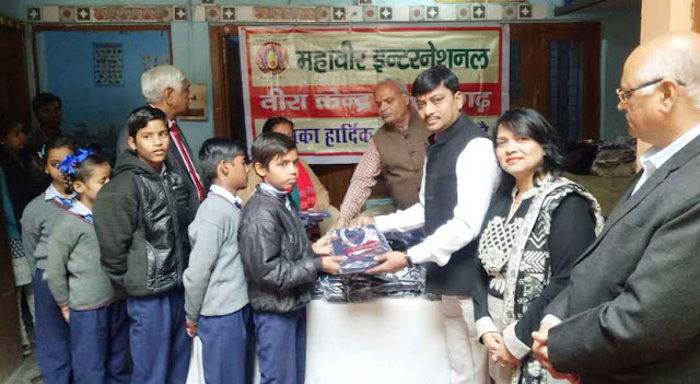 Seema Jain gave the sweater given to the needy children at the Human Vidya Niketan School