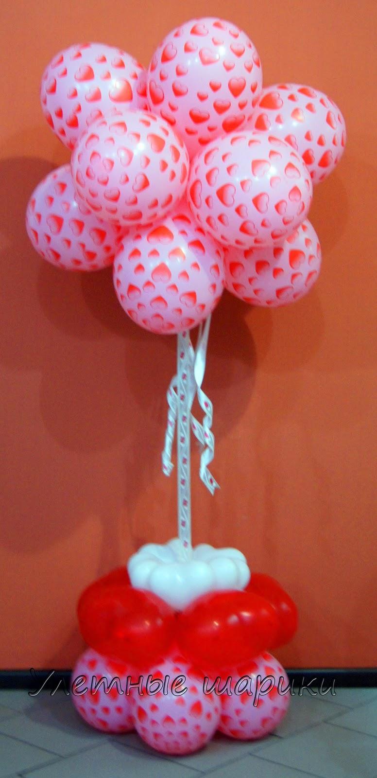 Облачко из воздушных шаров с сердечками