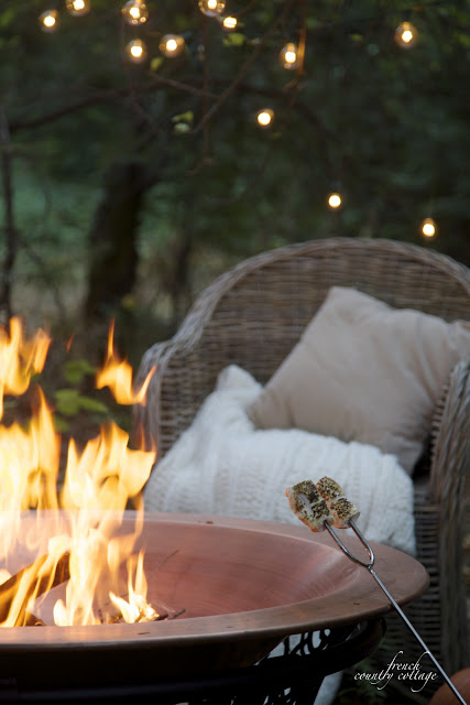 Autumn evening roasting marshmallows by fire