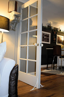 How to create a nook in a small living area; white sofa cover; french door divider;JoFer Interiors