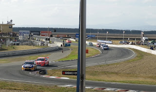 RACE CARS TAKING A CORNER