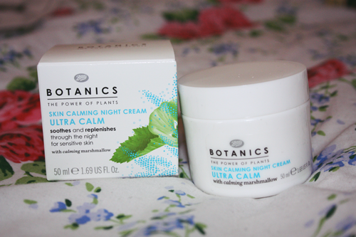 botanics 'ultra calm' skin calming night cream in its pot with the box next to it on a floral duvet