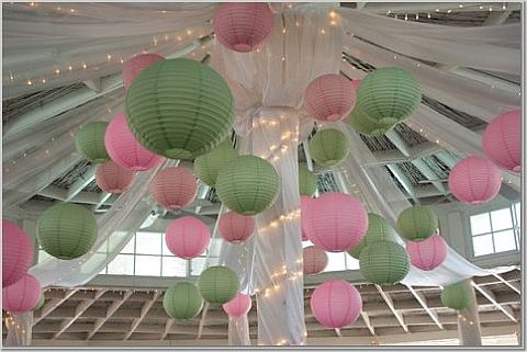 Green and pink wedding lanterns hanging on the ceiling