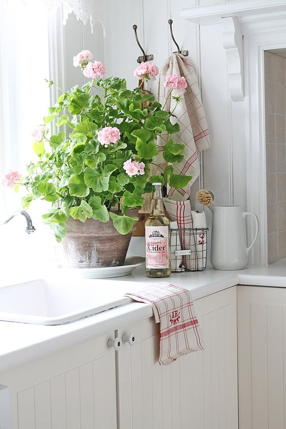 Spring pink farmhouse kitchen with flowers