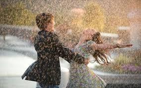 how to enjoy a rainy season wedding couple and rain of