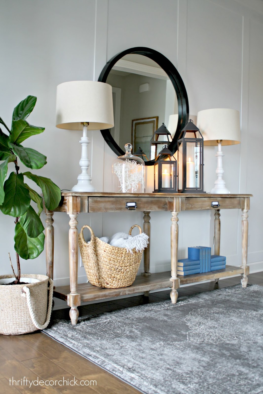 Everett hall table in foyer with black mirror
