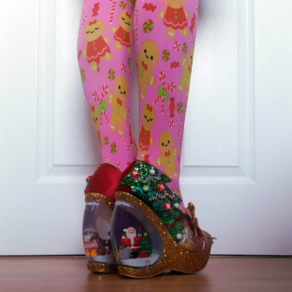 back angled view of snowglobe heeled shoes with reindeer, snowman and Santa inside