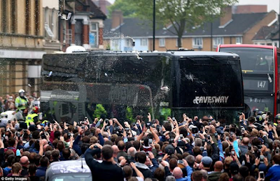 West ham fans mob Manchester united team bus outside upton park