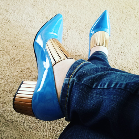 image of my feet clad in light blue patent shoes with a very pointed toe and gold detailing on the top and heel