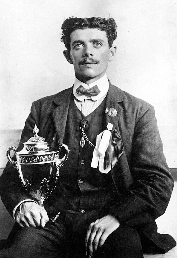Italian marathon runner Pietri holding the gilded silver cup from Queen Alexandra he was awarded in 1908 after being disqualified from his Olympic run.Your Russians are missing and other stories about past Olympics. marchmatron.com