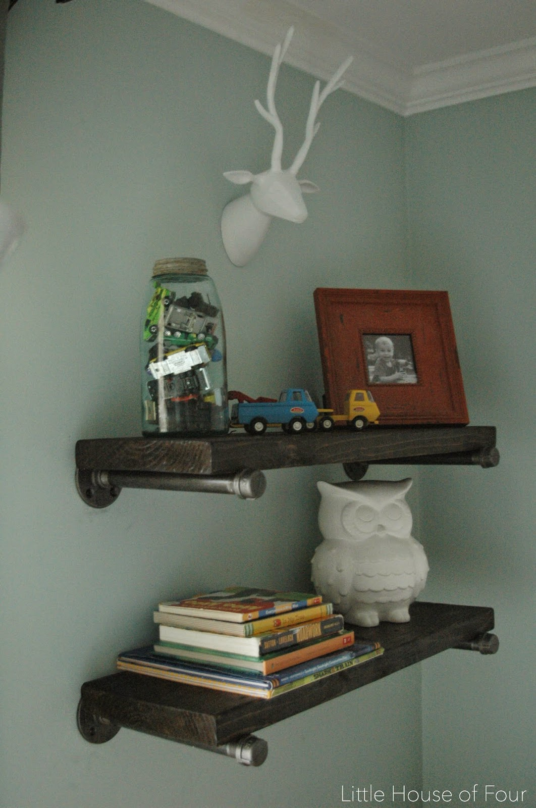 DIY wood and steel pipe wall shelves