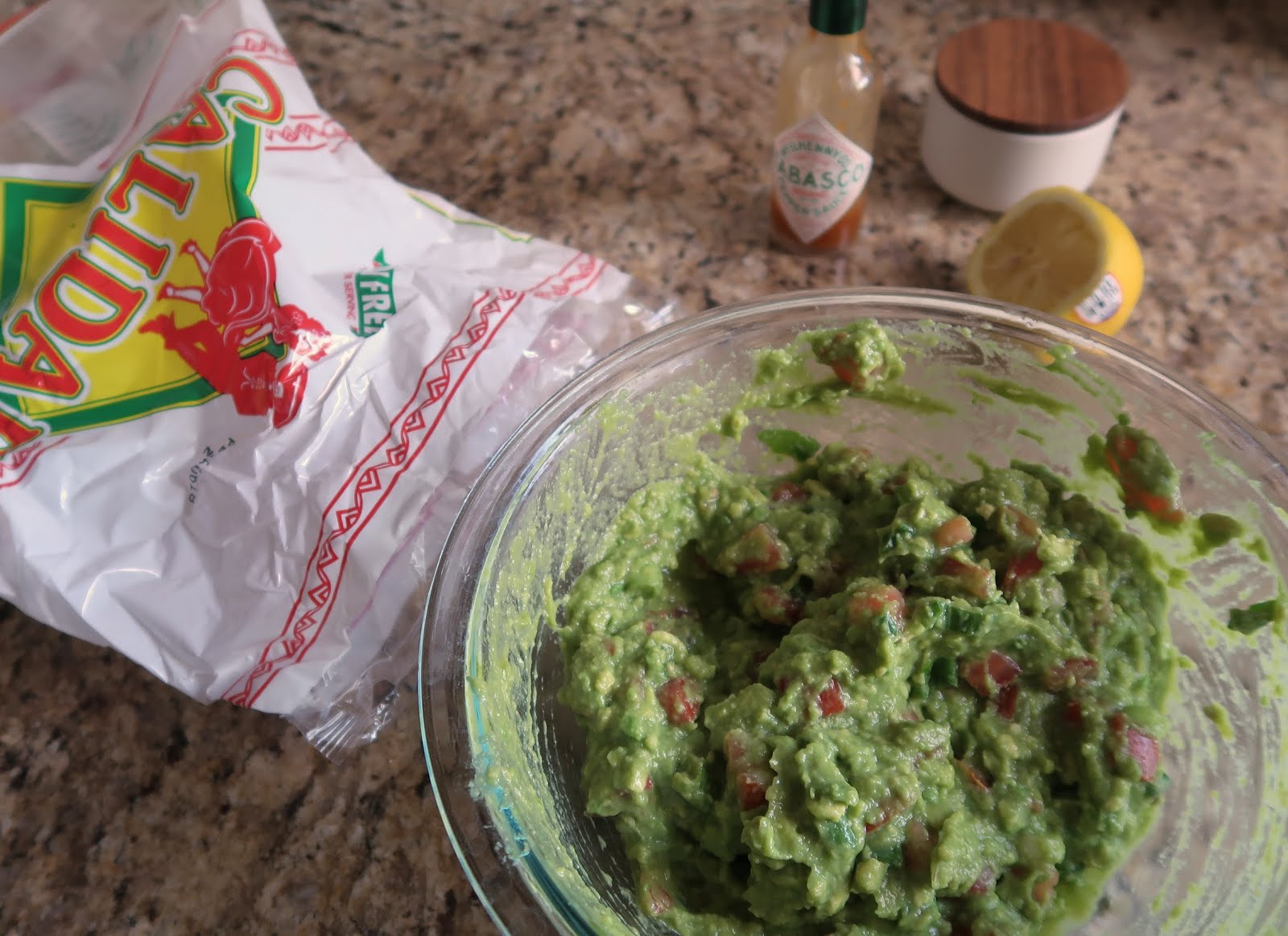 guacamole avocado tortilla chip lemon cinco de mayo summer recipe tomato green onion salt tabasco chips