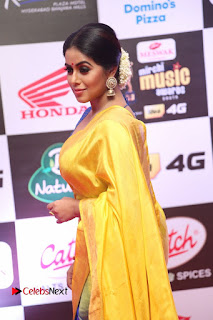 Actress Poorna Pictures in Yellow Saree at Mirchi Music Awards South 2015  0032