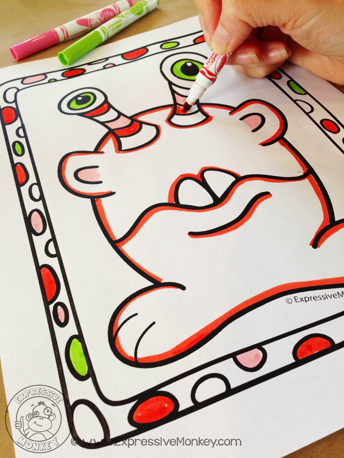 Expressive Monkey demonstrates how to make a monster using contrasting colors and a texture rubbing.