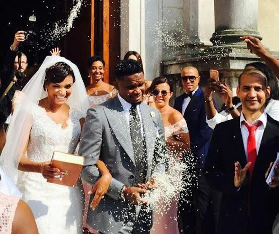 picture of samuel eto wedding with his wife gerogette  in a church in italy