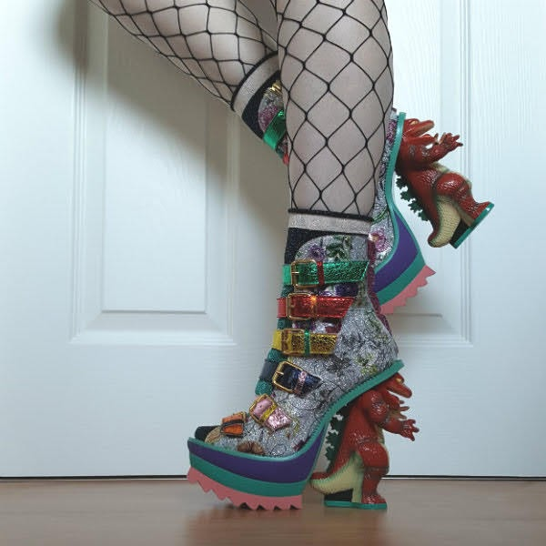 wearing character heeled dinosaur boots with fishnet tights
