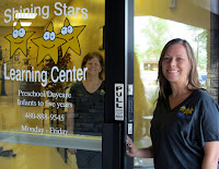 Image of Shining Stars Learning Center front door and staff.