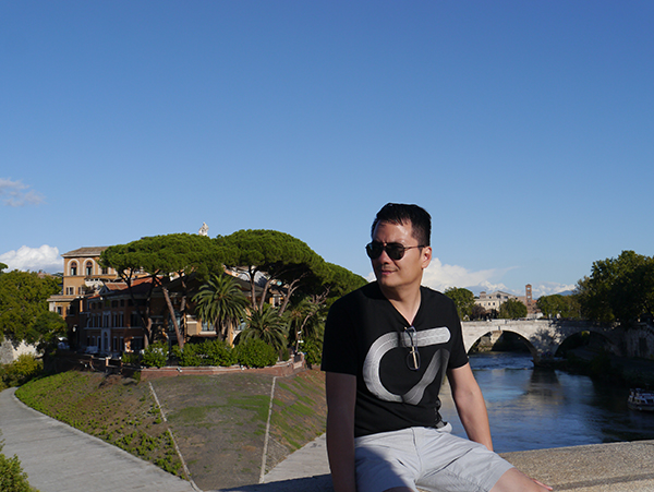 Admiring the view of the Tiber River in Rome
