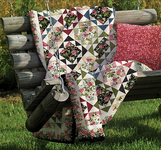 Garden Echo Quilt Free Pattern designed By Rachel Shelburne for Bear Creek Quilting Company, featuring fabrics from Poppies by Maywood Studios