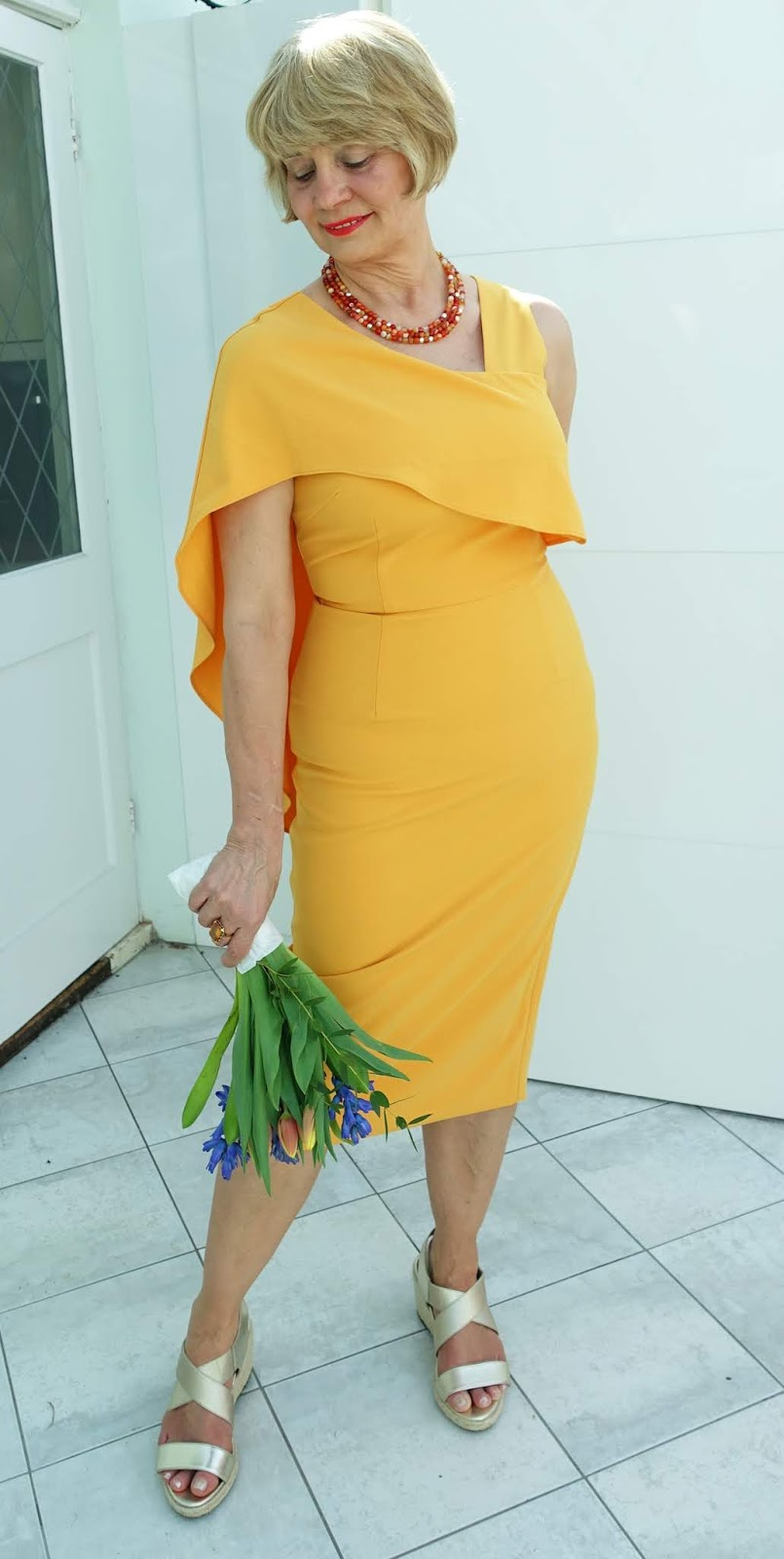 Gail Hanlon from Is This Mutton in tangerine dress by Lavish Alice and sandals by Vionic