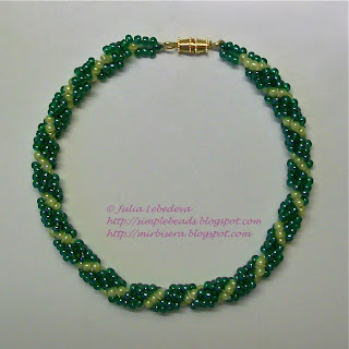 A bracelet of beaded spiral rope in green colors