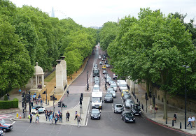View down Constitution Hill from the top of the Wellington Arch  showing the Green Park on the left  and Buckingham Palace gardens on the right