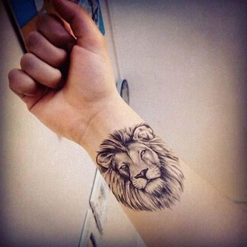 wrist lion tattoo bilek aslan dövmesi