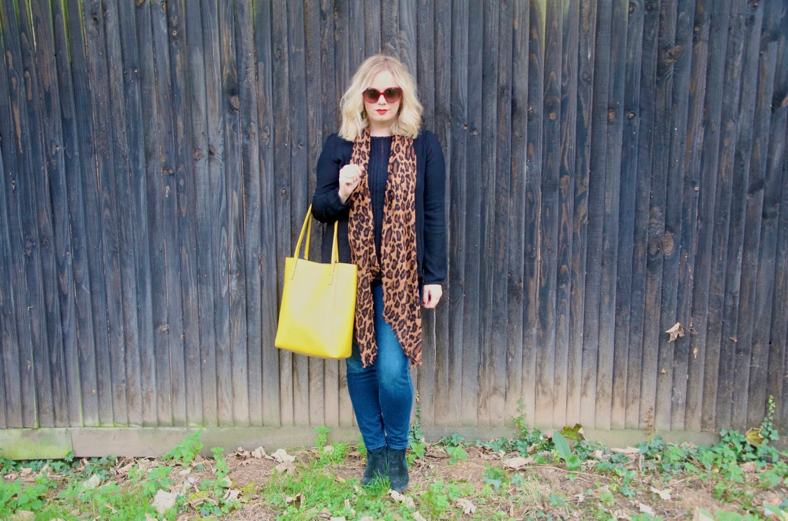 Yellow bag, leopard scarf, jeans and hot pink sunglasses