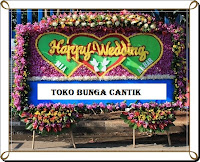 Pesan Bunga papan di toko bunga terbaik