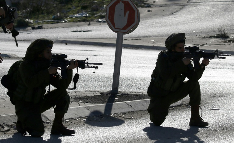 Israeli soldiers and Palestinian stone throwers clash east of Nablus, in the occupied West Bank