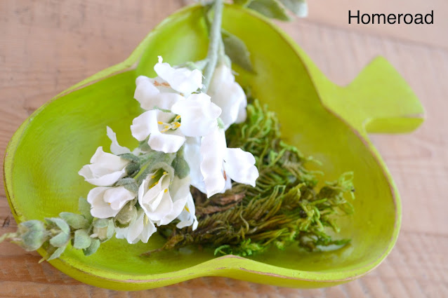 green bowl filled with flowers