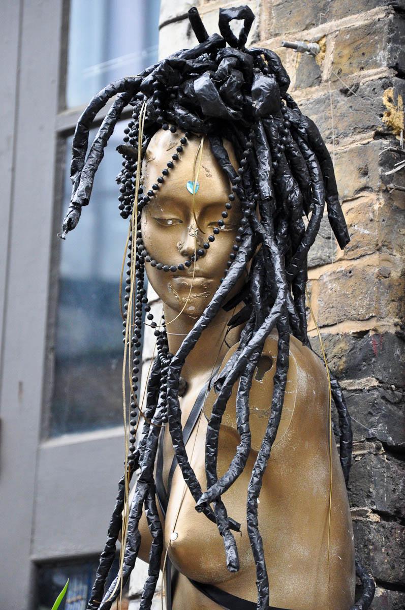 A mannequin outside of an alternative hairdresser's, Stables Market, Camden Town, London, England
