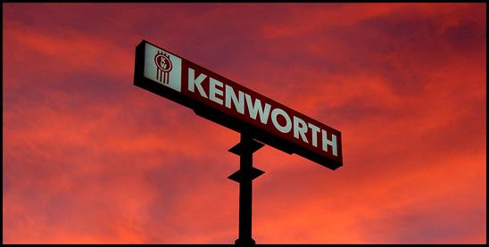 CIT Trucks Kenworth sign at sunset