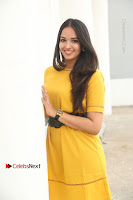 Actress Poojitha Stills in Yellow Short Dress at Darshakudu Movie Teaser Launch .COM 0077.JPG