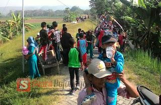Ratusan Masyarakat Desa Semambung Meriahkan HUT RI ke 72 dengan Jalan Santai