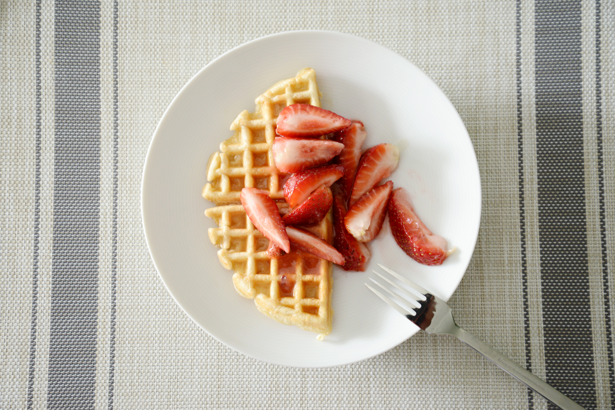 macerated strawberries and waffles