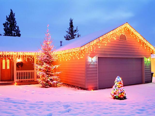 Afbeelding huis en garage met lampjes