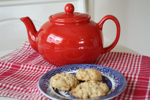 red tea pot and cookies