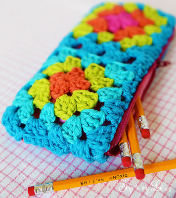 http://www.skiptomylou.org/crochet-granny-square-zippered-pouch-tutorial/