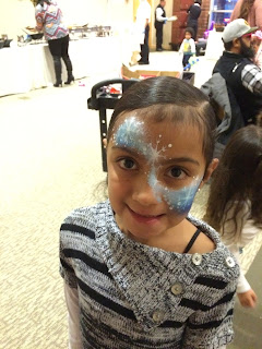 A young girl who got a Frozen design painted on her face