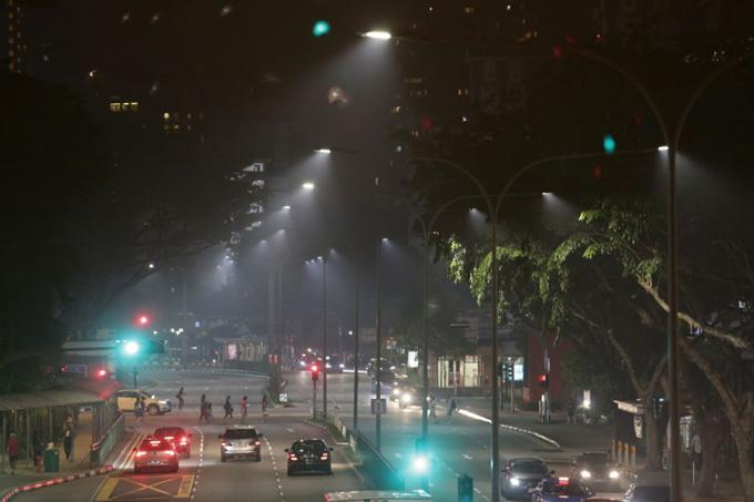 A strong odour that smelt like burning chemicals or petrol, along with smoke that stung the eyes, fanned anxiety among many people yesterday as it spread from north-eastern parts to the western areas of Singapore.