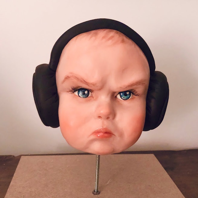 This is a sculpted chocolate head cake made during a workshop