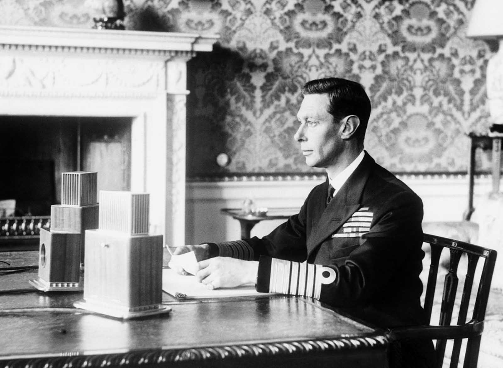 Britain's King George VI broadcasts to the British nation on the first evening of the war, on September 3, 1939, in London.