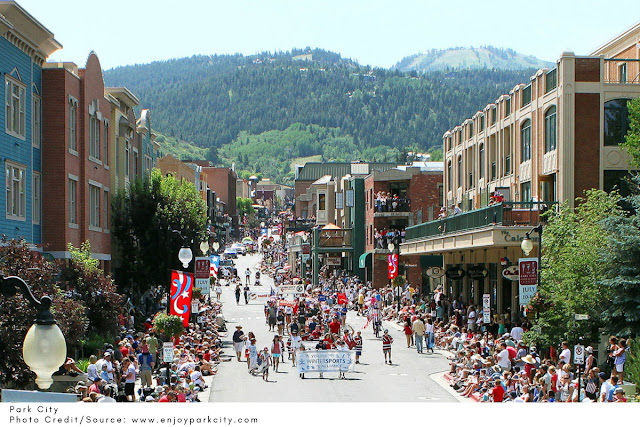 crowds of people watching a parade on Main Street in Park City